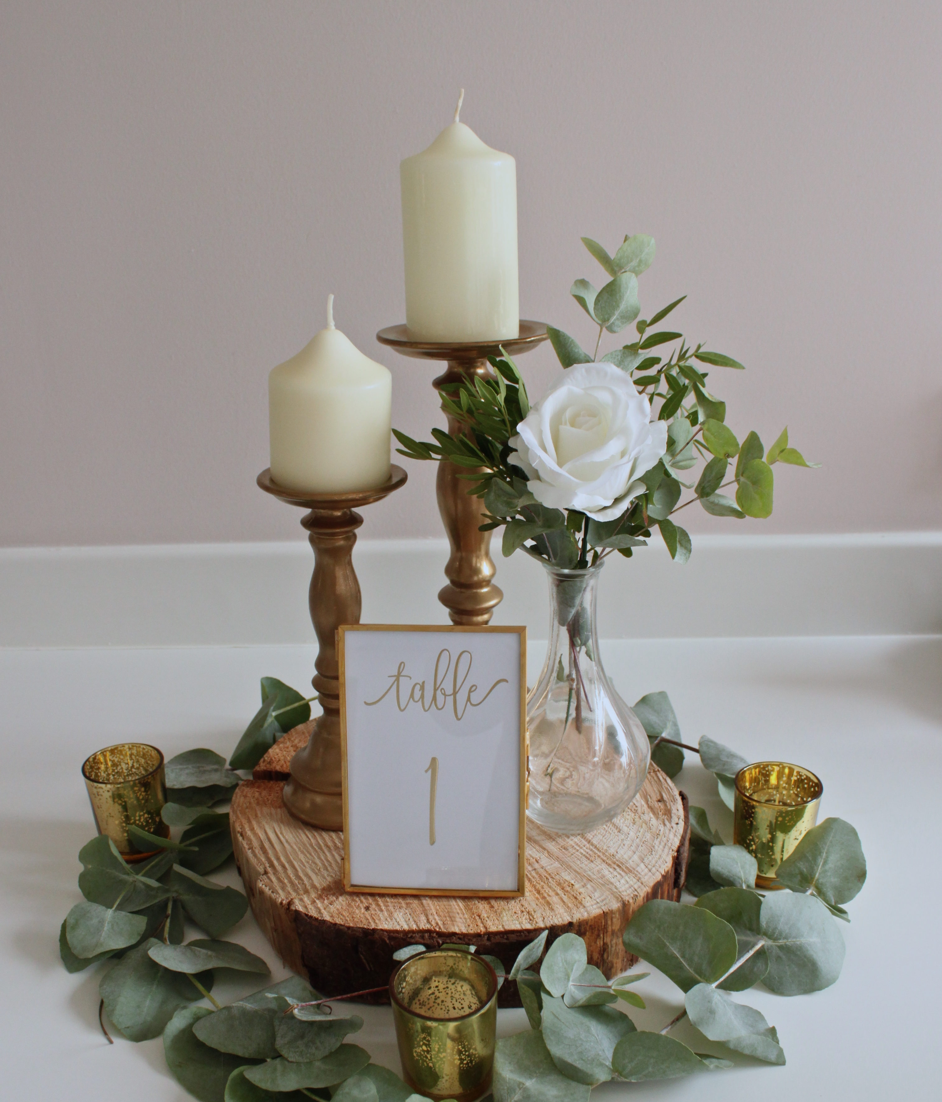 The white wedding company / wedding decor styling / candle centrepiece