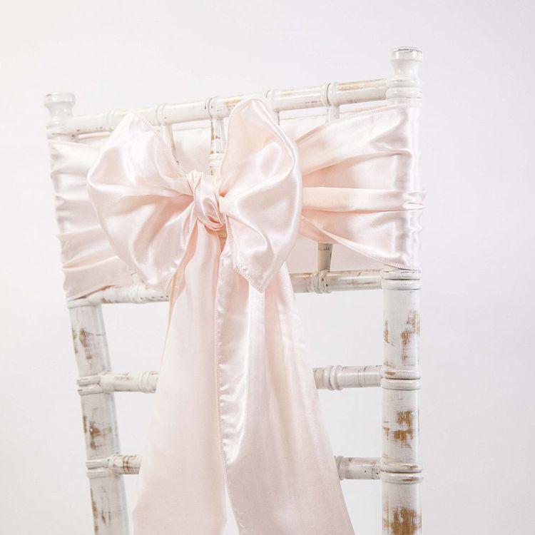 The white wedding company / chair sash